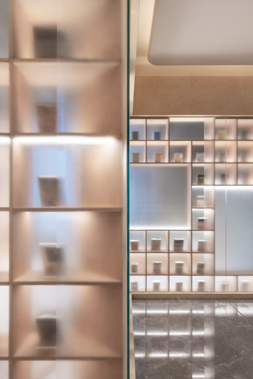 A bookcase covered in frosted glass inside The Glade Bookstore