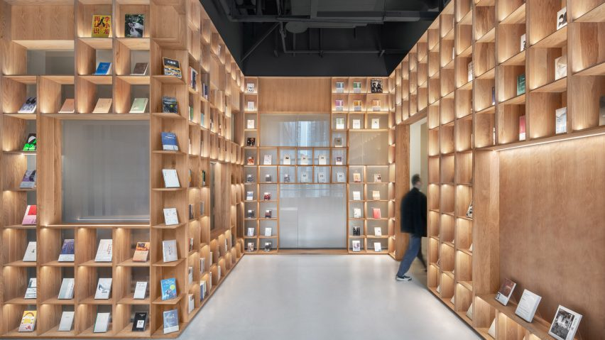 Wooden bookshelves line The Glade Bookstore by HAS Design and Research
