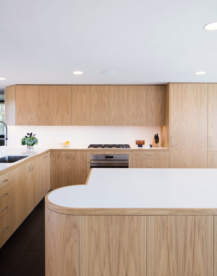 The kitchen boasts Corain countertops in a white hue