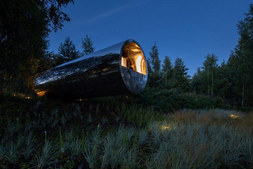 Tube houses by Sergey Kuznetsov at night with spot lights illuminating the surroundings