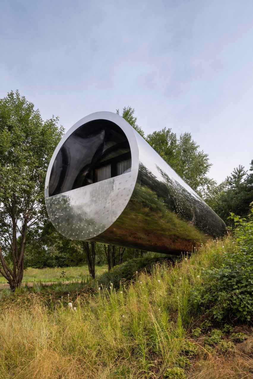 Tube-shaped house with stainless steel cladding by Sergey Kuznetsov