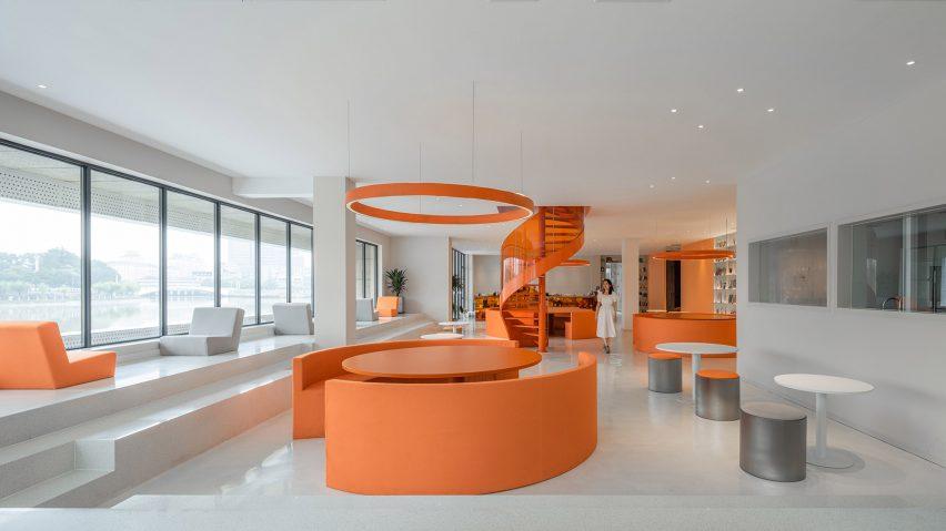 Circular orange seating booths in cafe of Duoyin bookstore