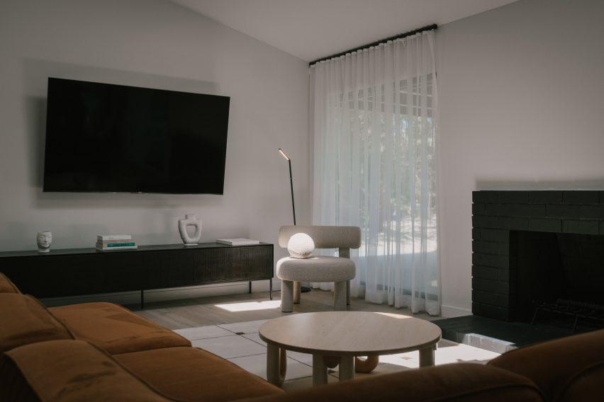 The living room has a velvet sofa