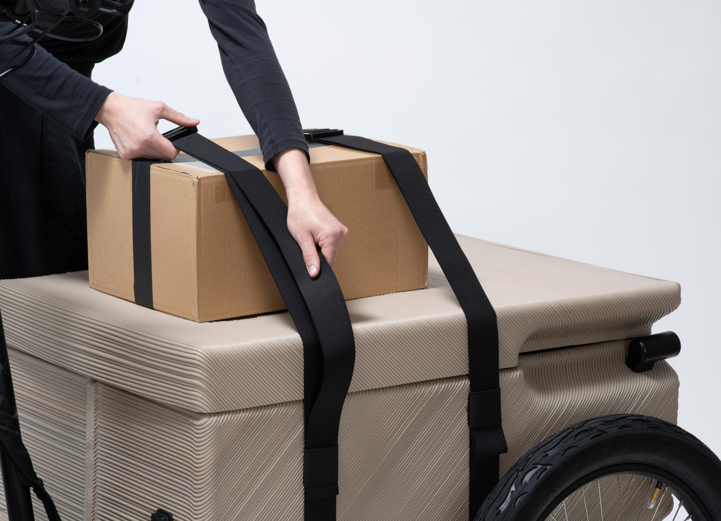 Cardboard box strapped onto transport box of ZUV