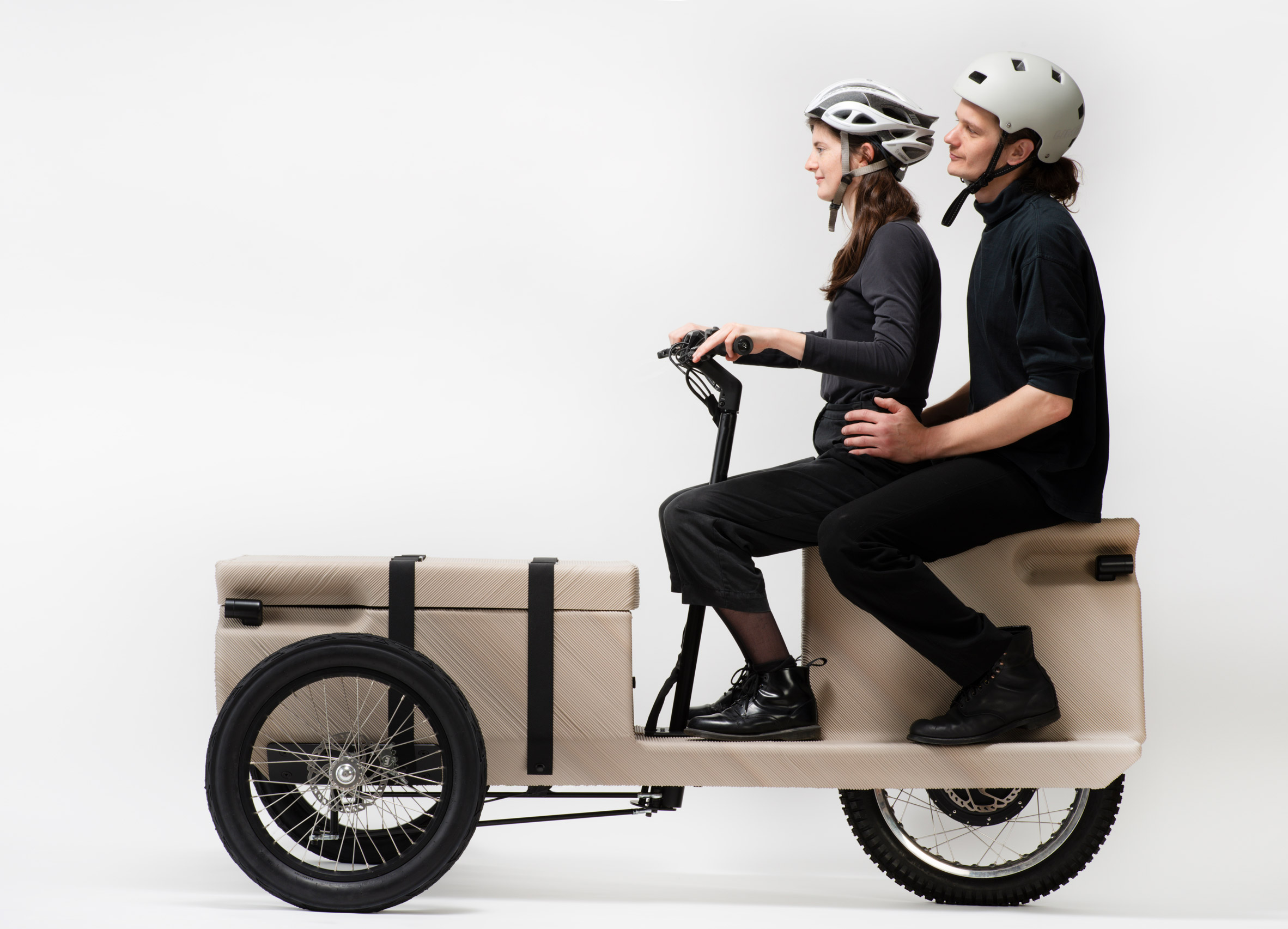 Two people sitting on a 3d printed bicycle by EOOS NEXT