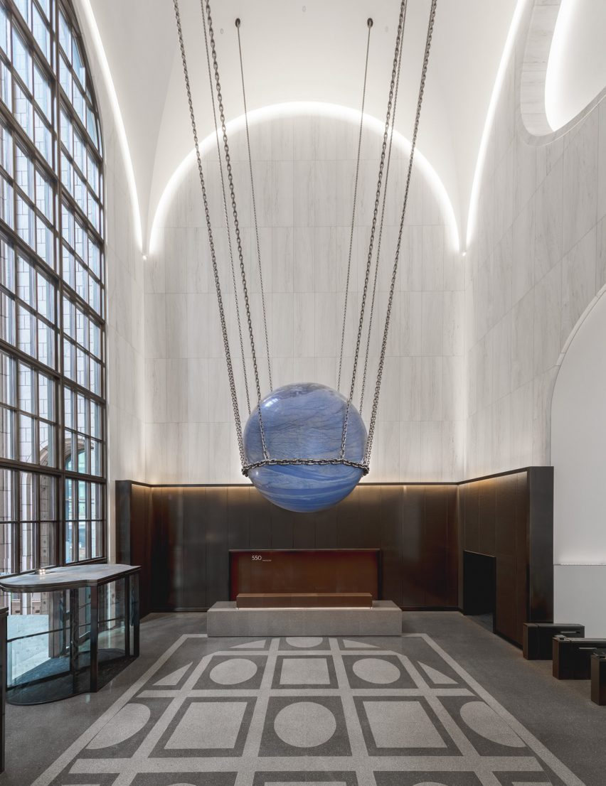 White marble was used across the walls of the lobby of 550 Madison