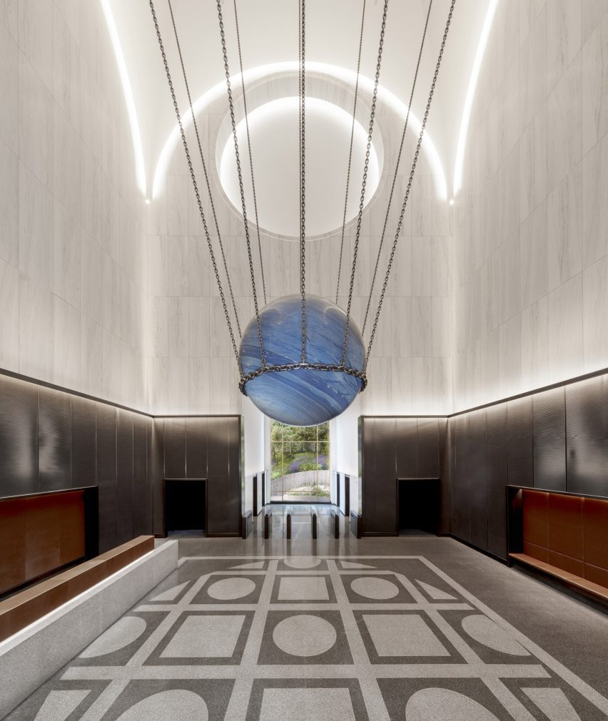 A sculpture by Alicja Kwade is hung in the centre of the lobby of 550 Madison