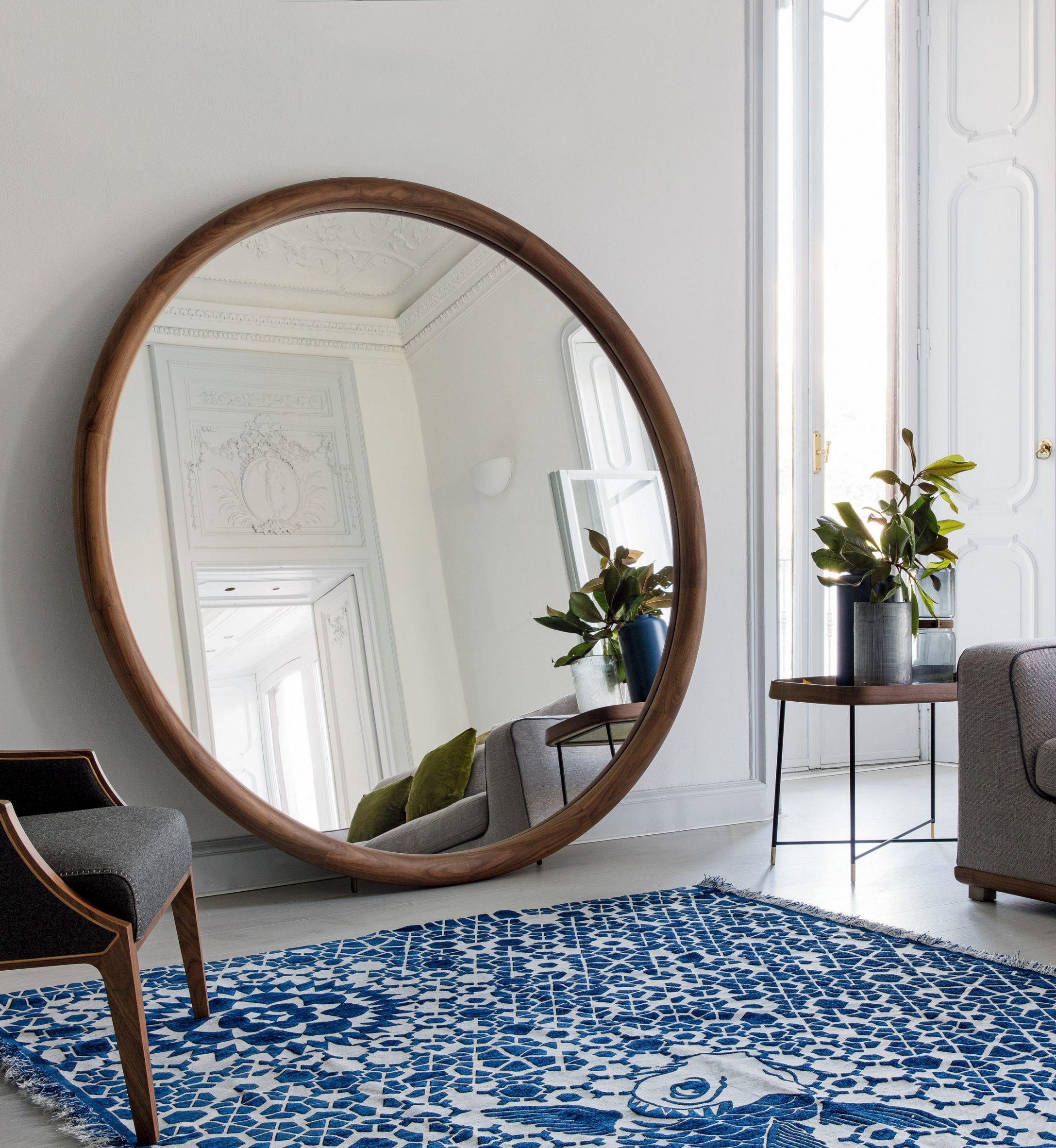 A photograph of a round wooden mirror
