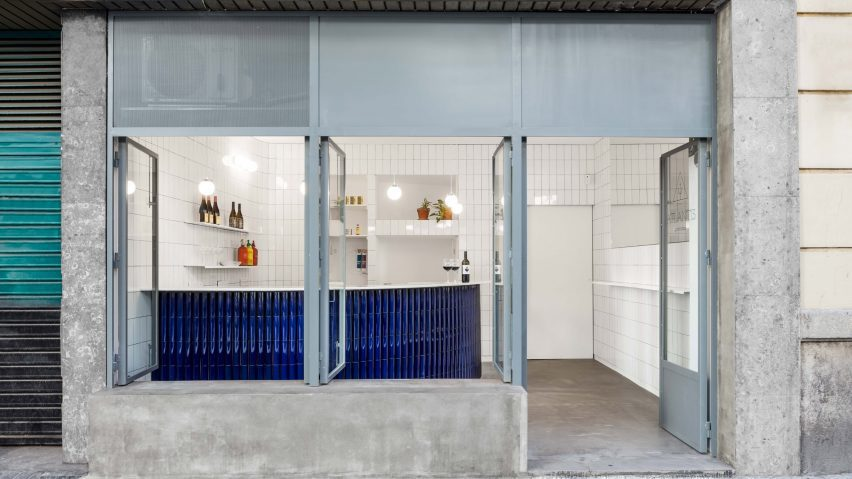 A photograph of a gastro bar that uses blue and white tiles