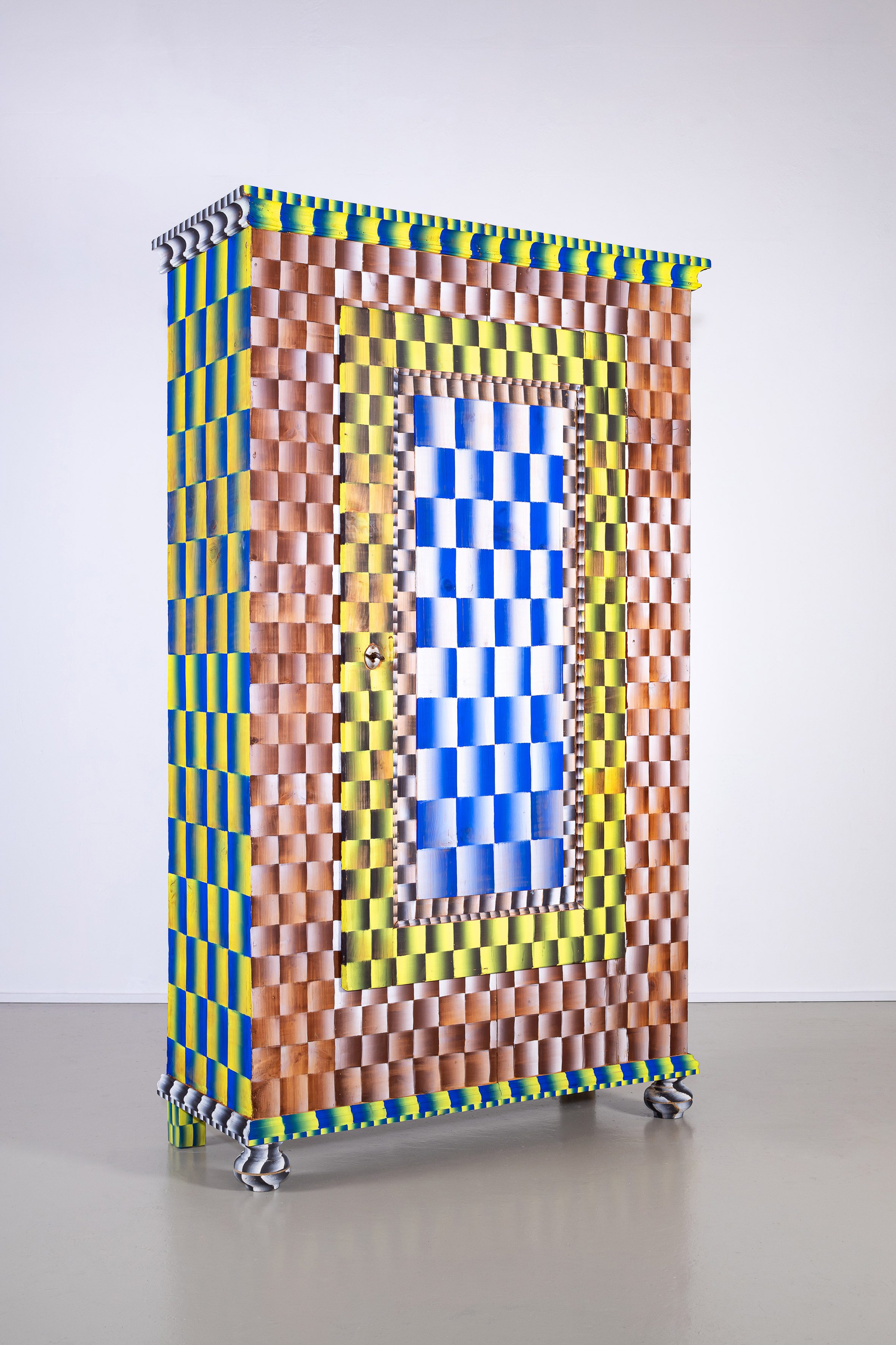A photograph of a colourful up-cycled cabinet as part of London Design Festival