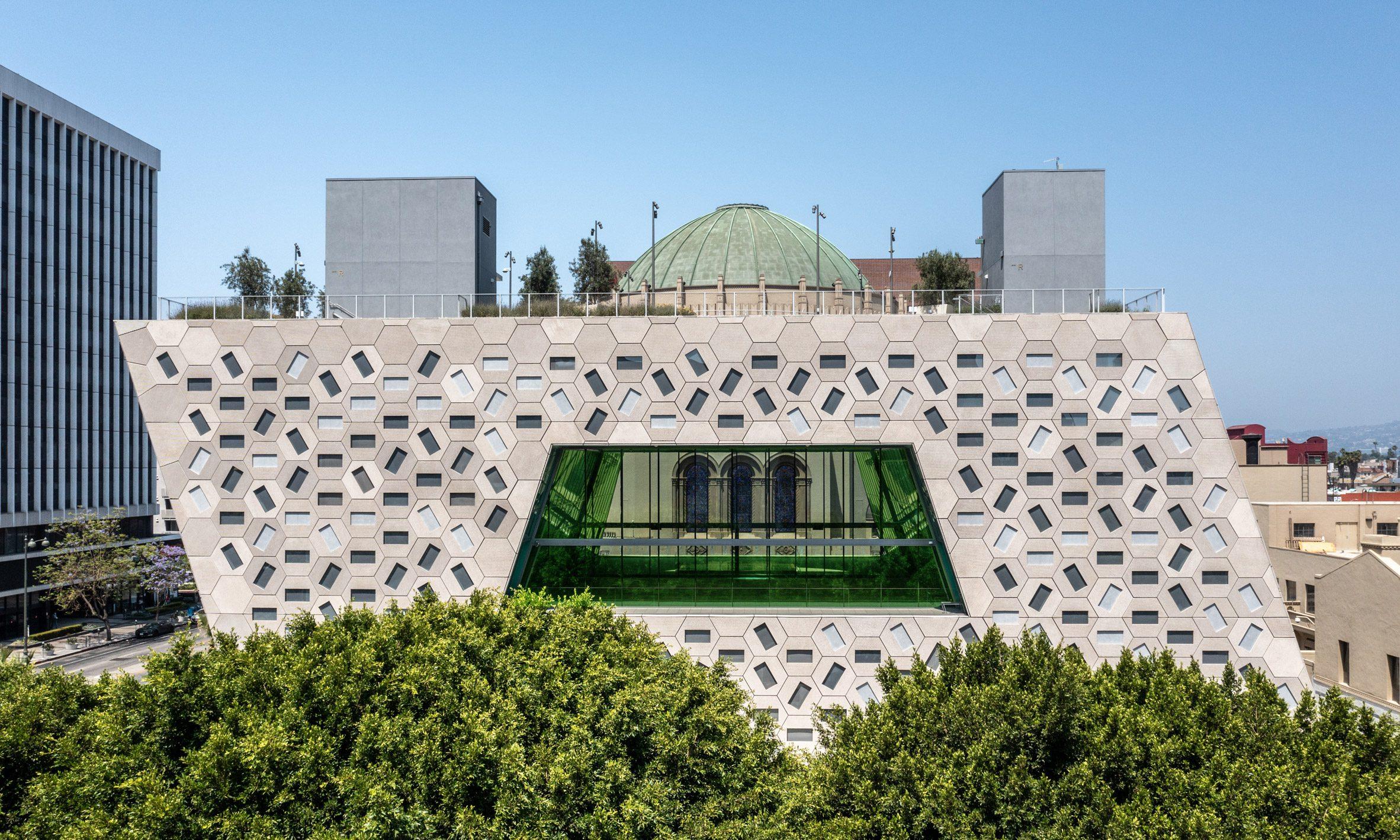 Hexagonal tiles covering the building's facades