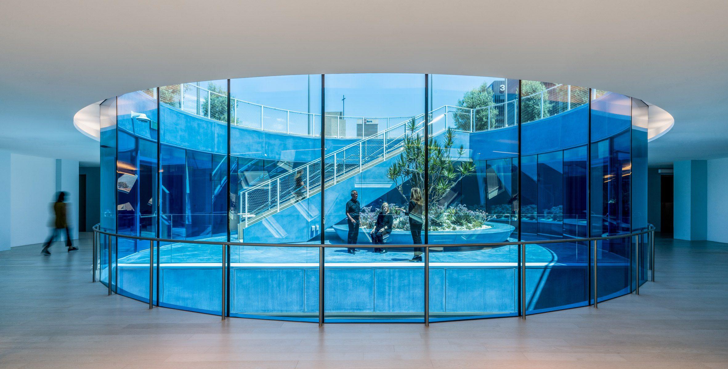 Blue glass surrounding the sunken roof garden