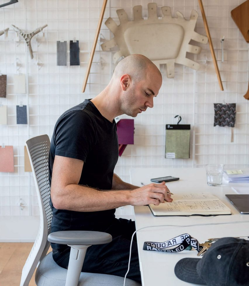 Benjamin Hubert sat at a desk with a notebook