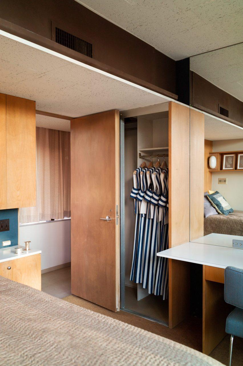 Garments hung in a bedroom wardrobe