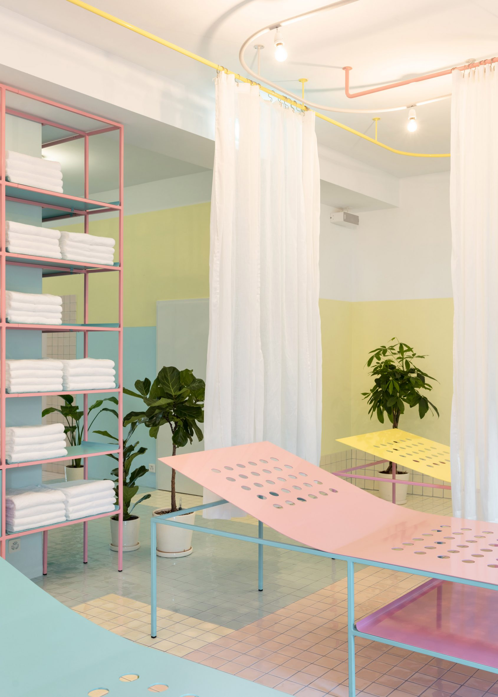 Pastel coloured lounges and tiled floors in Origin Spa