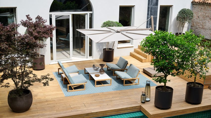 Aerial view of Carlotta armchair by Cassina on a patio