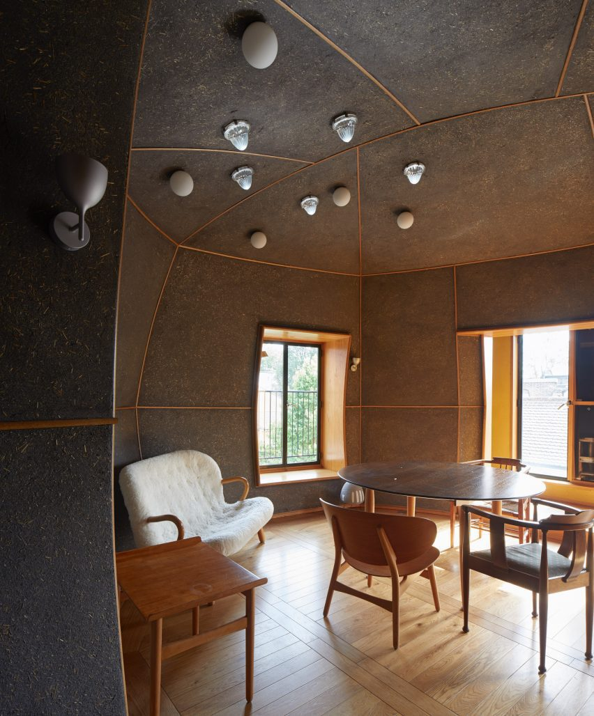 A table and chairs inside a room covered in Clayworks' Arakabe wall finish