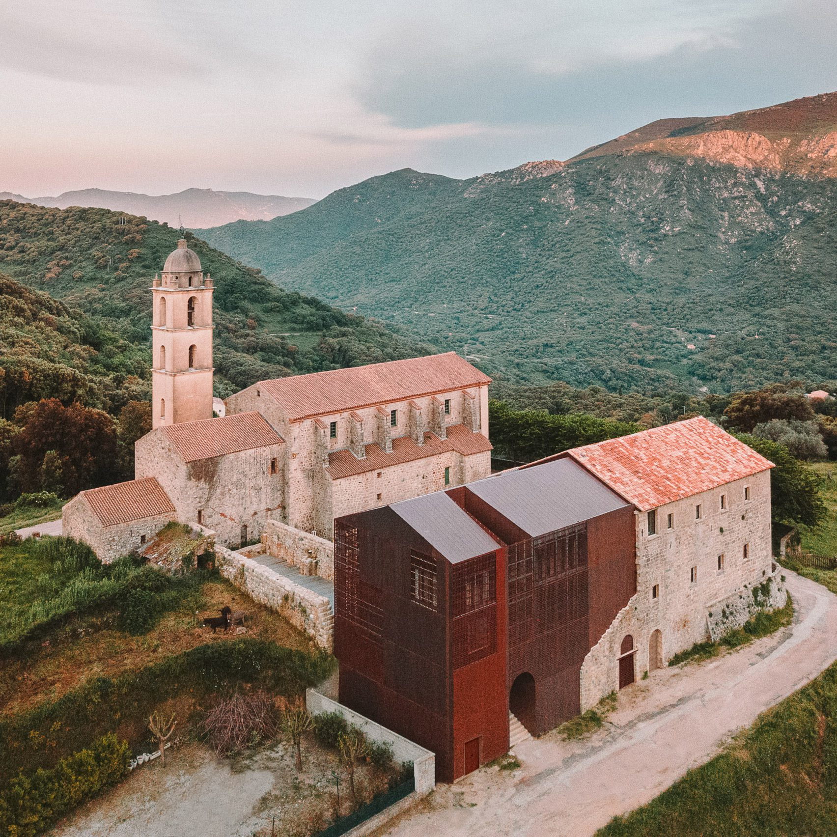 Amelia Tavella Architectes adds perforated copper extension to a Corsican convent