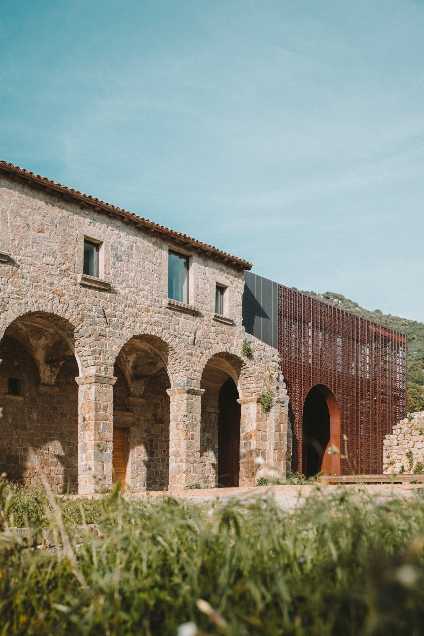 Large arches punctuate the walls of the structure