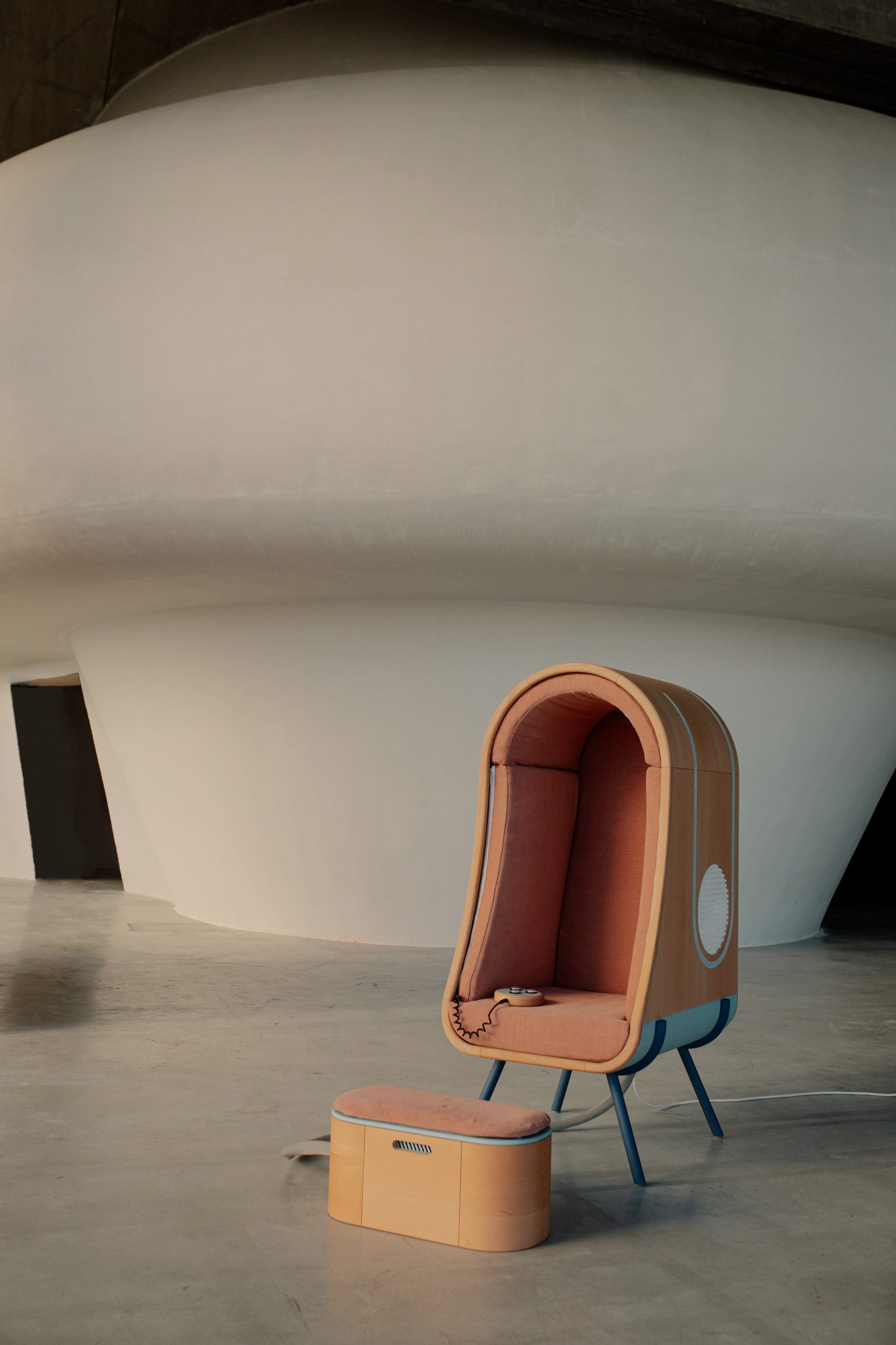 Oto hugging chair and footrest for people with autism