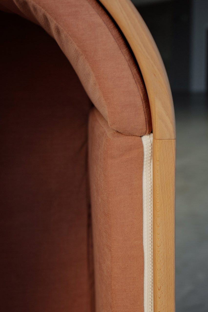 Zipper on side of wooden chair by Alexia Audrain