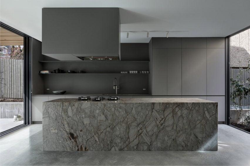 A grey kitchen inside Courtyard House