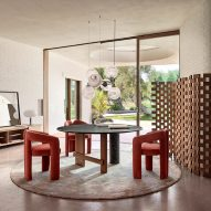 A dining room with Dudet chairs
