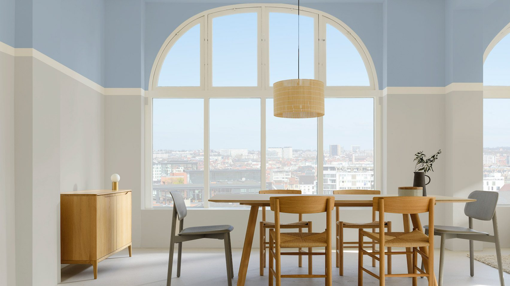 A dining room painted in Dulux blue skies colour