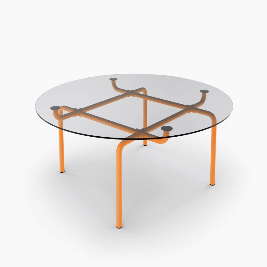 The Edison table with orange-painted steel legs
