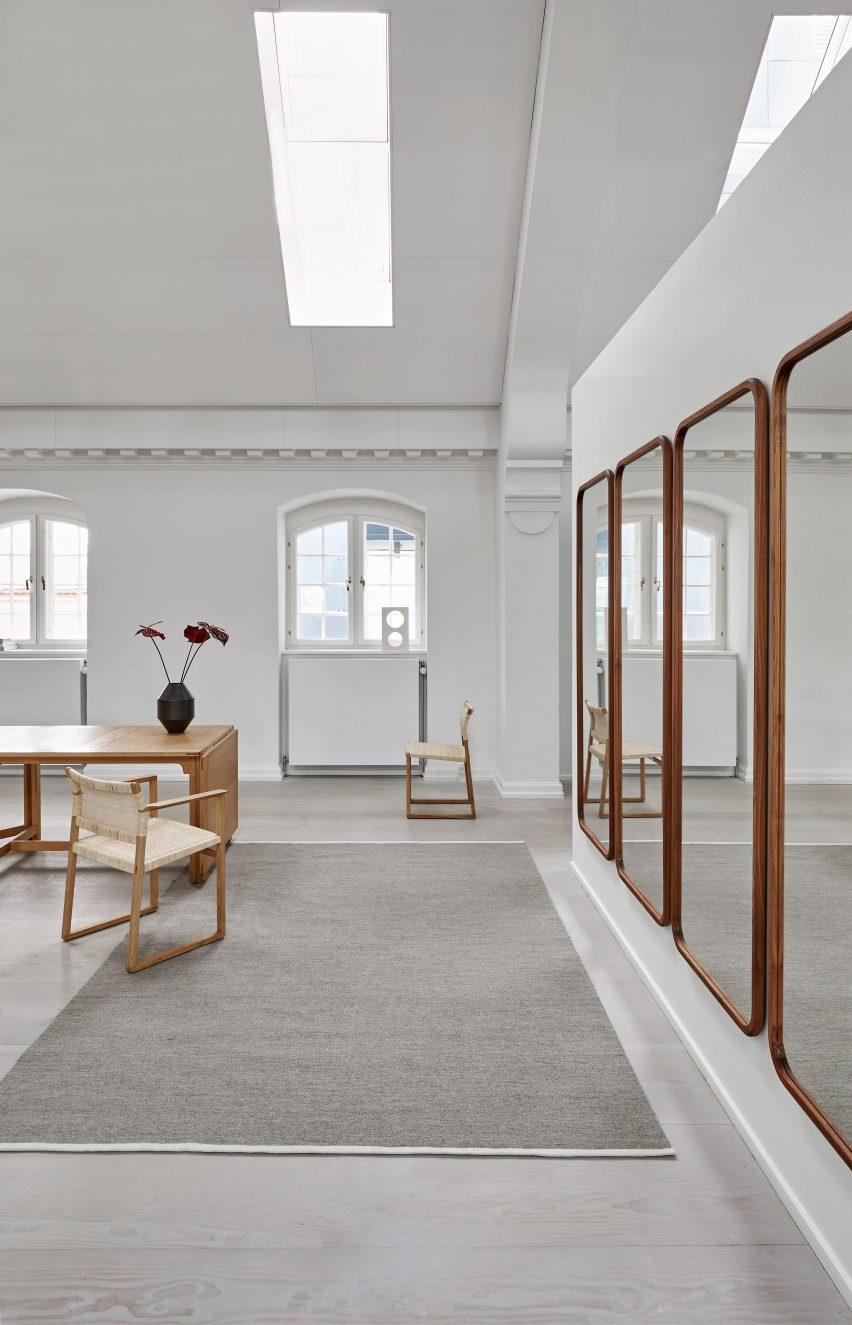 A photograph of Escape Kelim rug by Space Copenhagen for Massimo Copenhagen