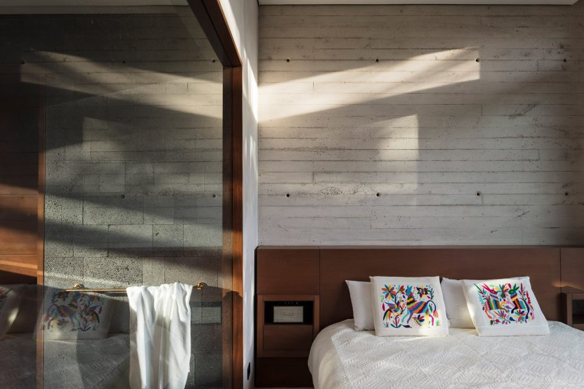 A guest bedroom with concrete walls