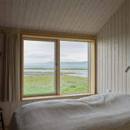 Wood-lined bedroom overlooking Icelandic nature reserve