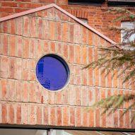 Brick facade with a blue window