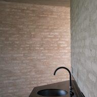A brick-walled bathroom