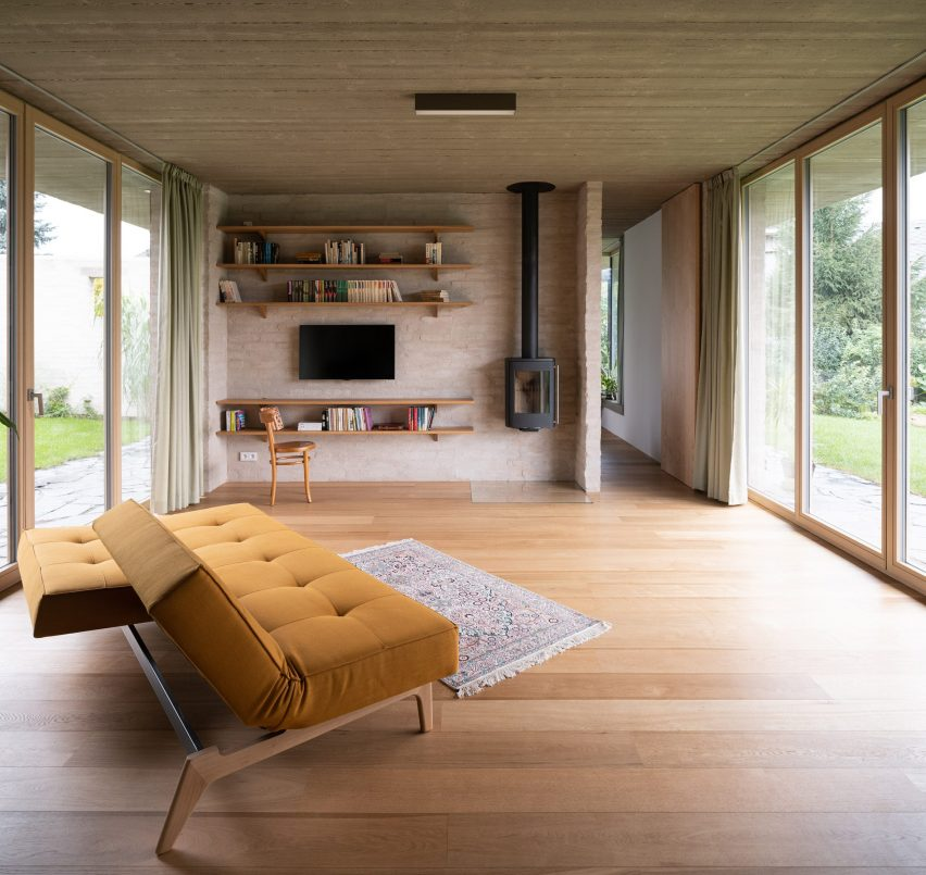 A living room with brick walls