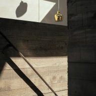 Concrete interiors of House with Courtyards