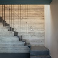 Concrete stairwell in House with Courtyards
