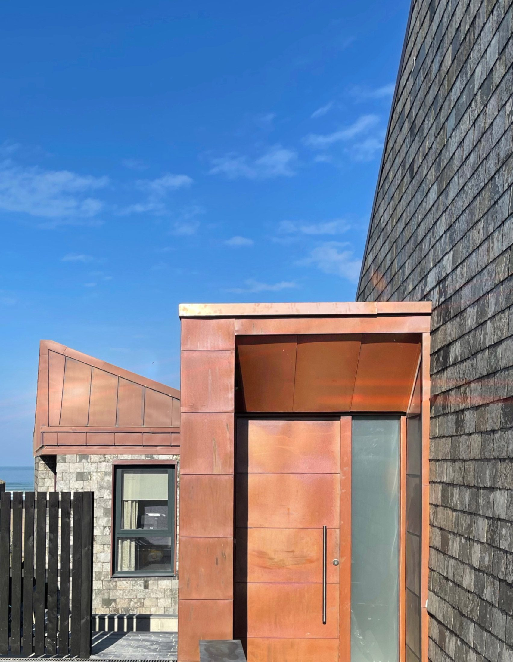 A copper and slate-clad house