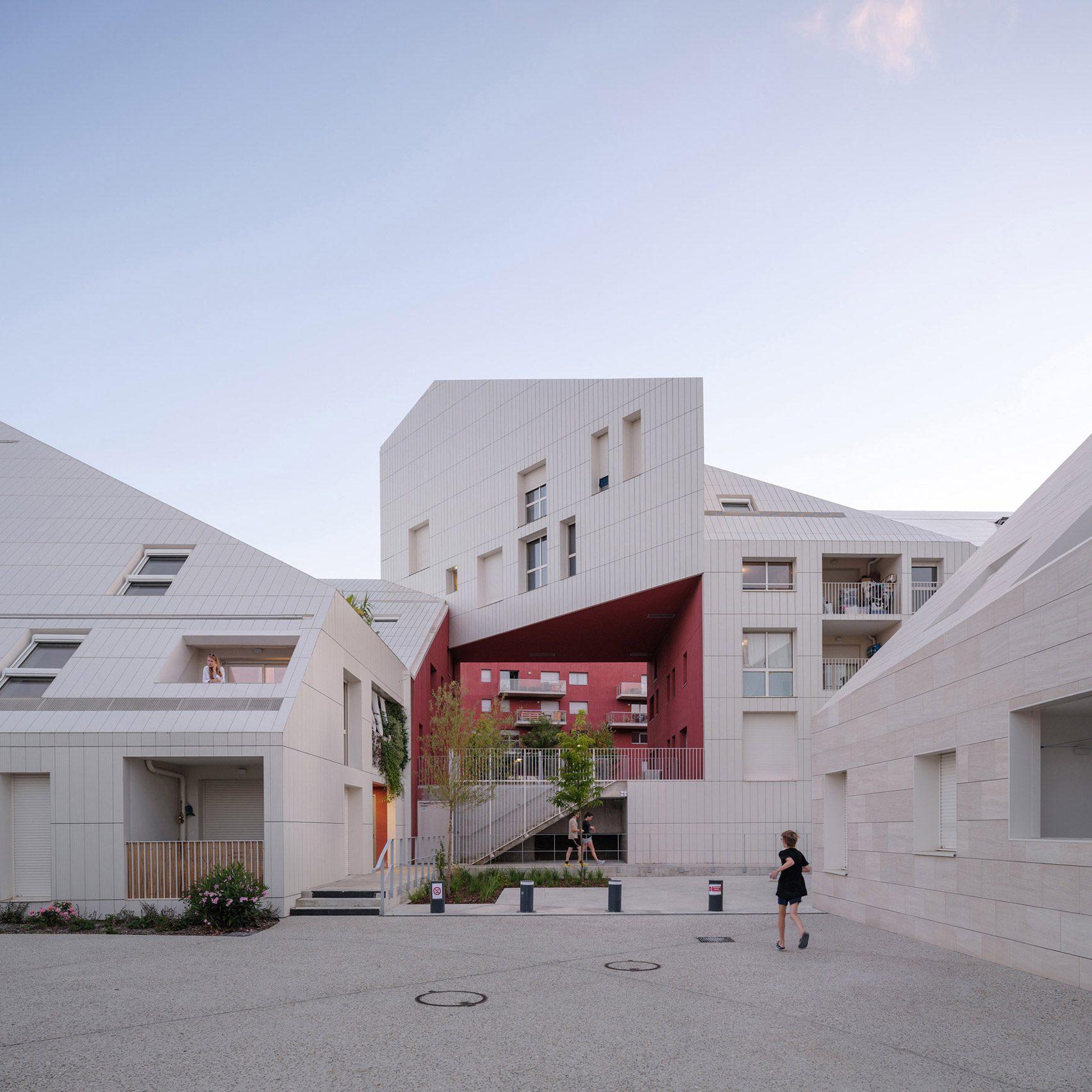 MVRDV slots red-walled courtyard into irregularly shaped French housing