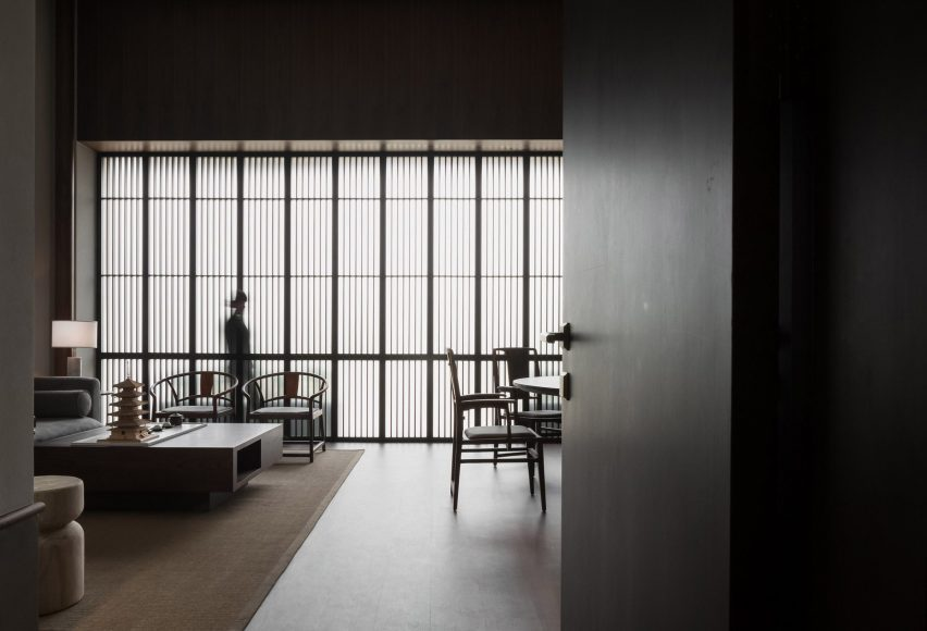Interior by JG Phoenix with translucent screens and wooden furniture