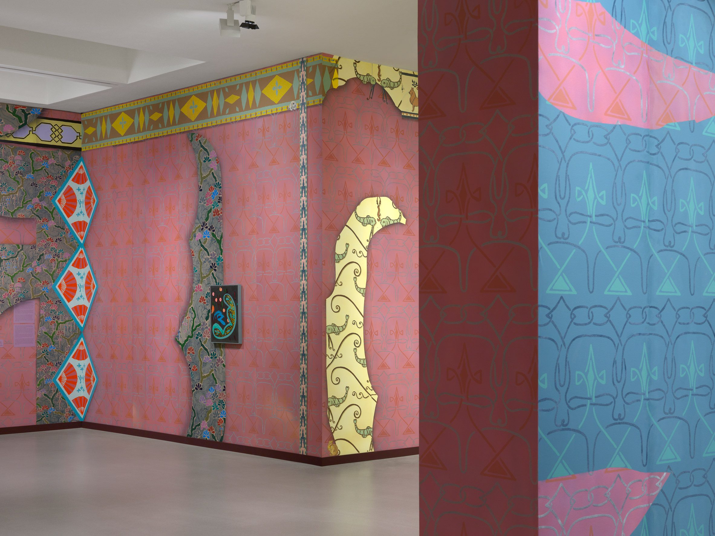 Pink and blue wallpaper on the walls of Fondation Vincent van Gogh Arles