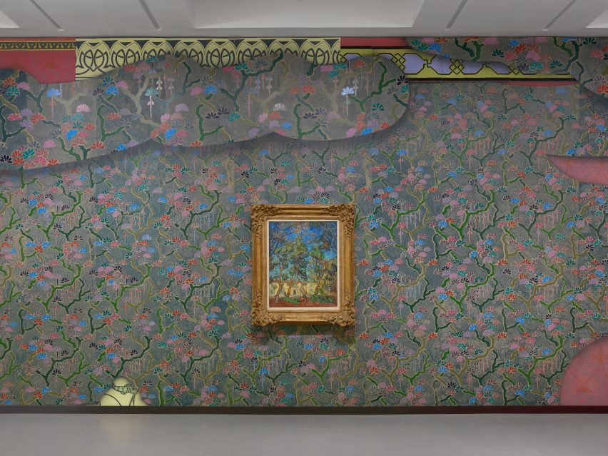 A Vincent van Gogh painting hanging on a colourful wall