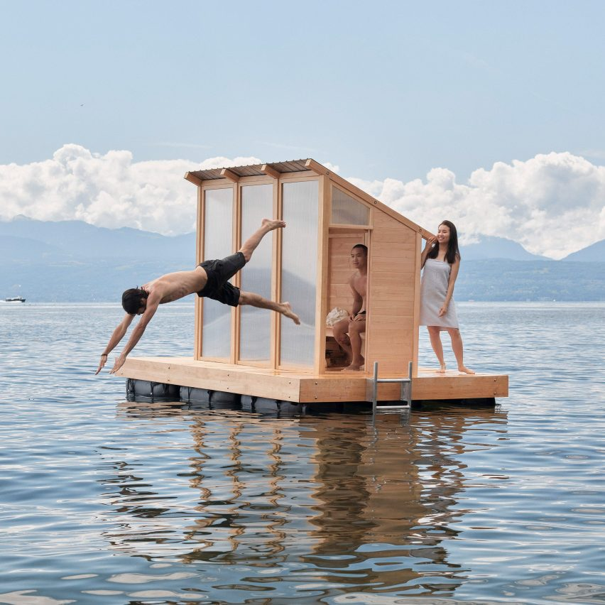 People diving off the deck of the sauna