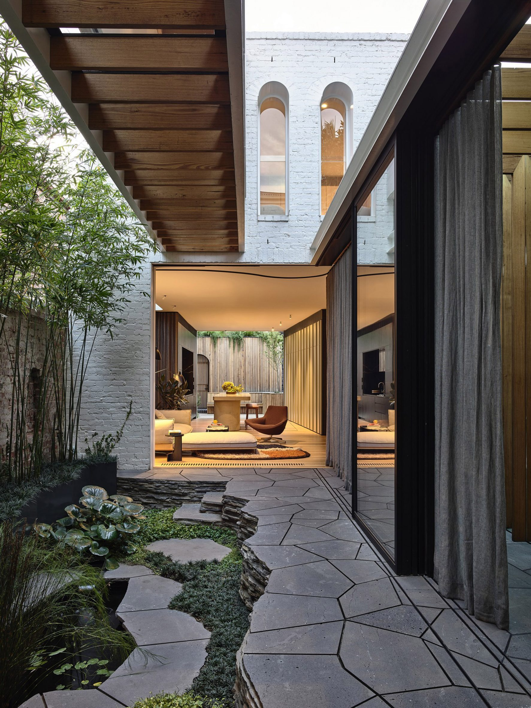 Fitzroy Bridge House living area opens out to the courtyard