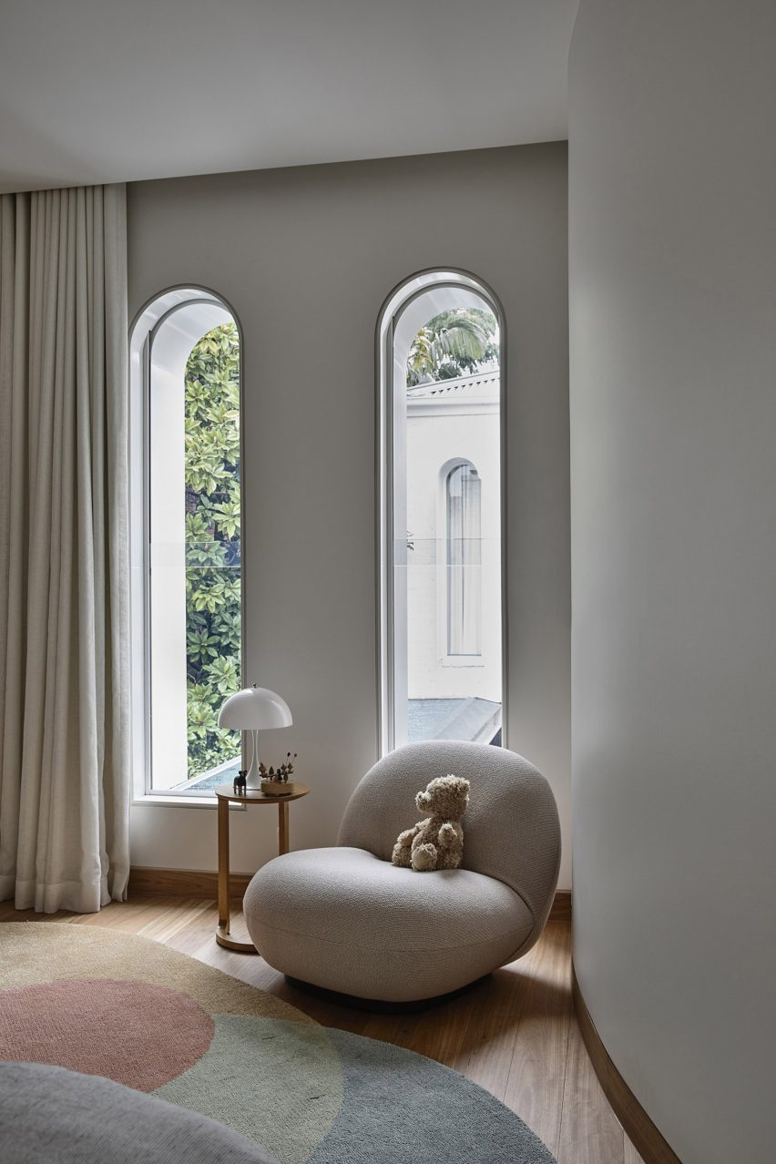 Tall and slender arched windows look out to the garden at Fitzroy Bridge House