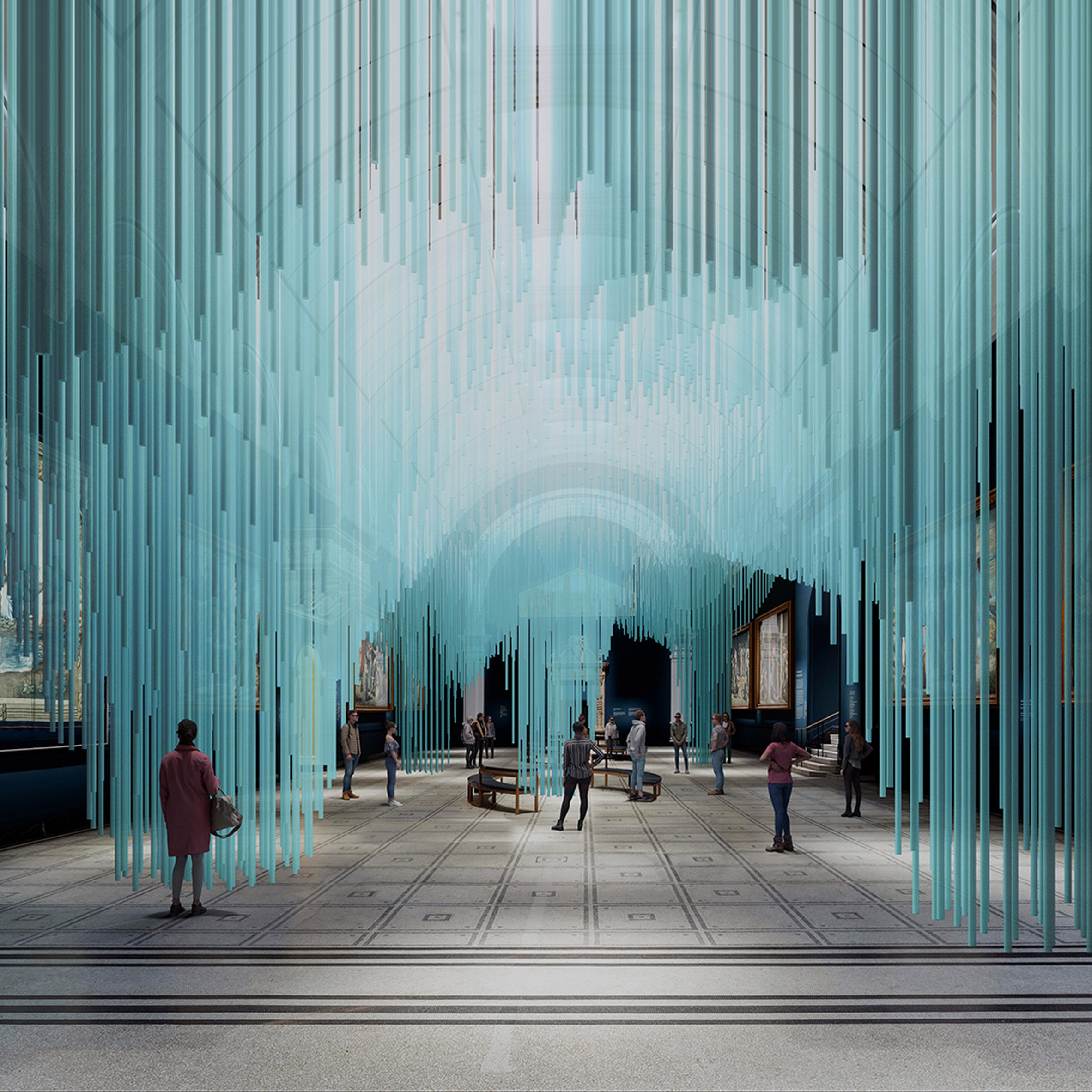 Visitors walking through a blue light installation