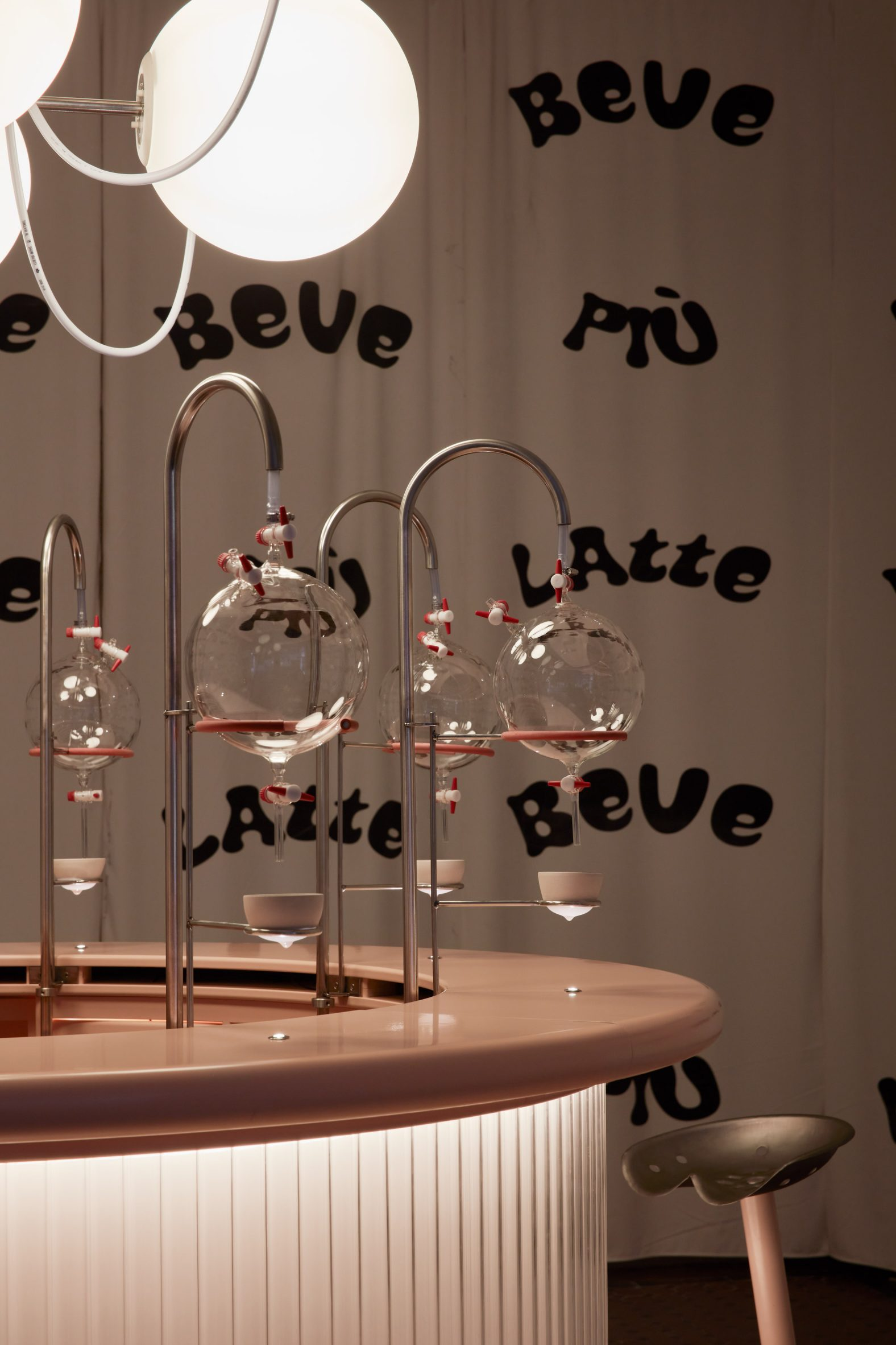 Pink bar with breakers and breast-shaped cups in Korova Milk Bar installation from Clockwork Orange
