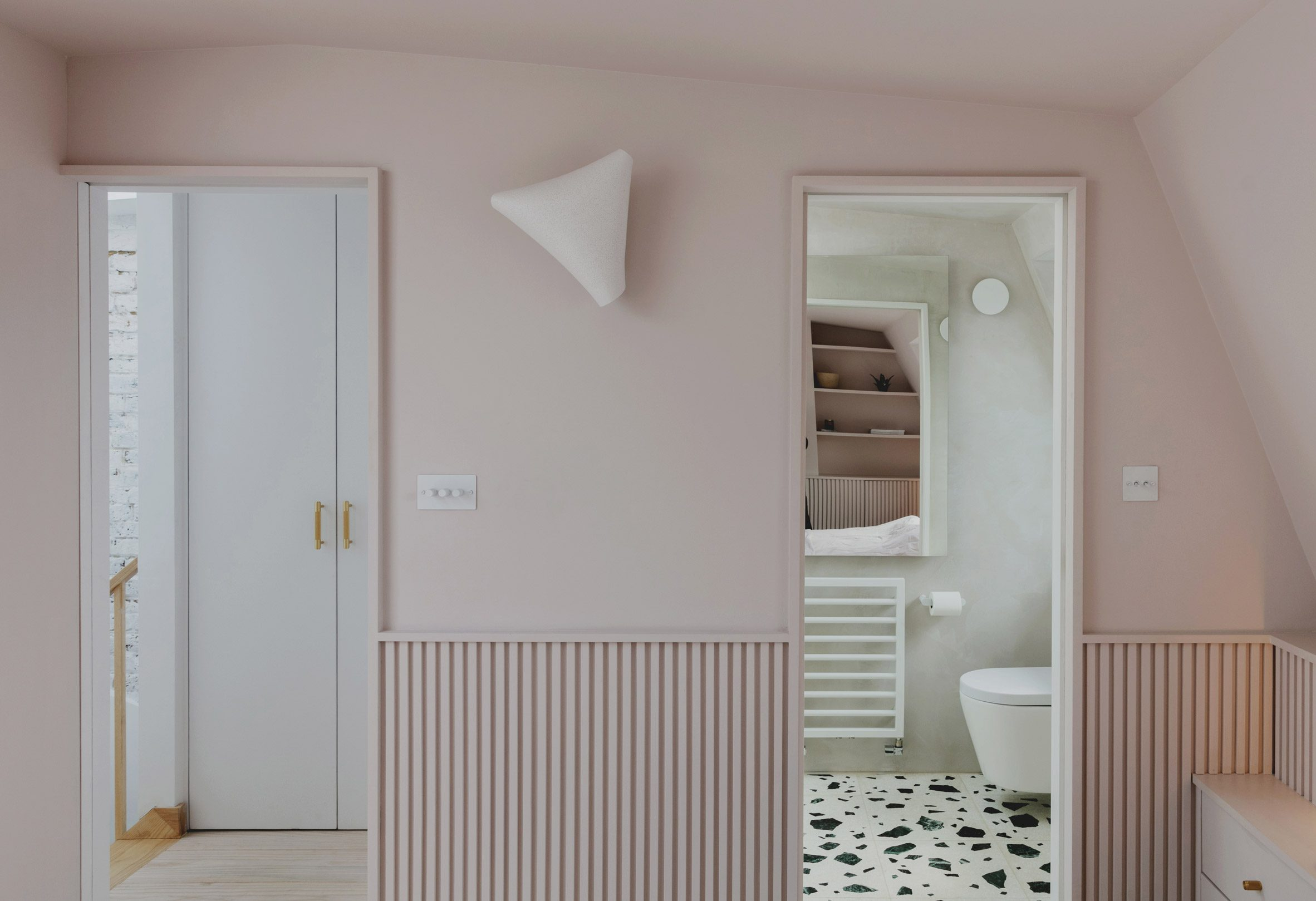En-suite bathroom in Bed and window in Narford Road loft extension by Emil Eve Architects