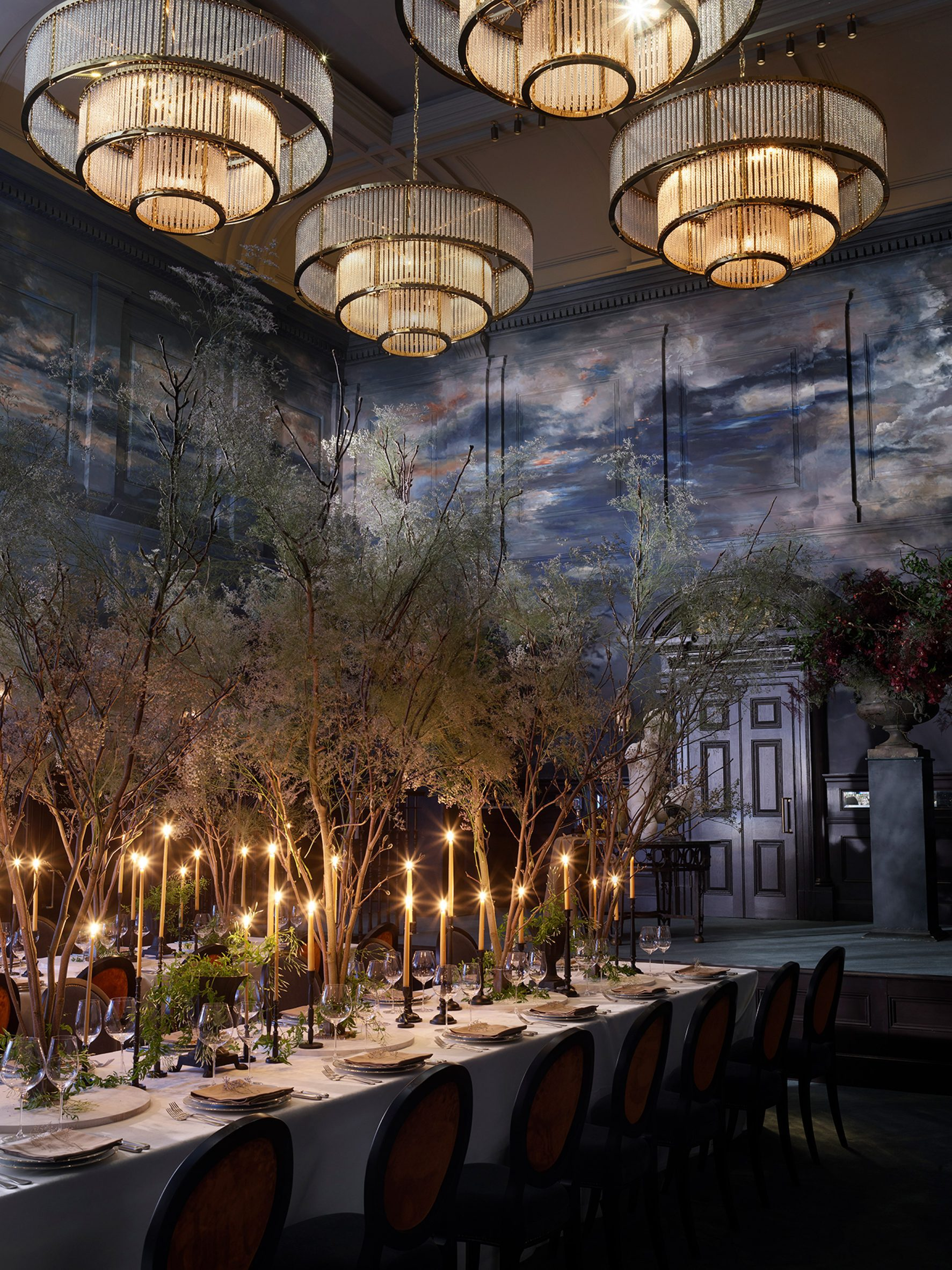 Ballroom interior by Roman and Williams with tiered chandeliers