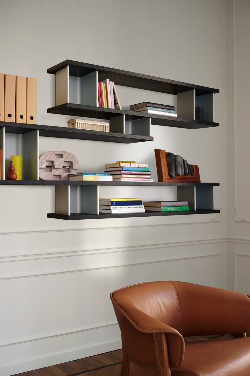 A photograph of the wall-mounted shelf system